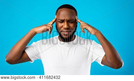 Brainwork. Thoughtful African American Guy Thinking On An Idea Massaging Temples With Eyes Closed St