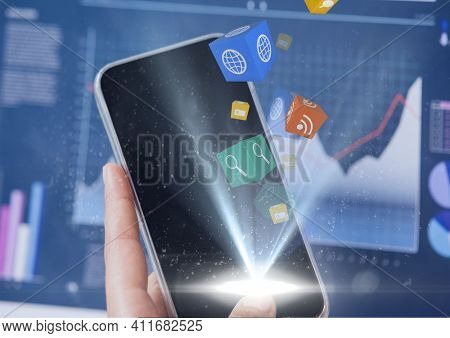 Social media icons floating over hand holding smartphone against statistical data processing. social media networking and technology concept.