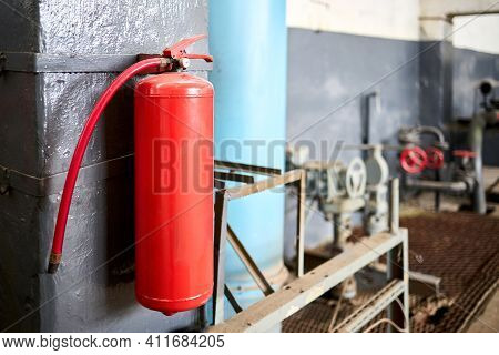 Fire Extinguisher Equipment In Factory For Fire Protection System. Carbon Dioxide Fire Extinguisher