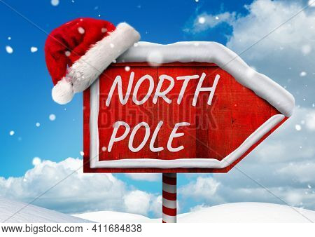 North pole text on red board sign with santa hat and winter landscape in background. christmas greetings, celebration and festivity concept digitally generated image.
