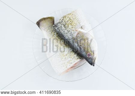 Top View Of Barramundi Fish Over White Background.