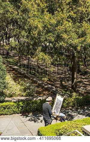Charleston Sc - March 28, 2019: An Artist Draws An Autumn Landscape In A Park In Charleston Sc.