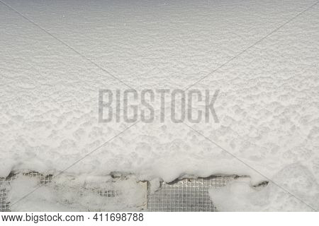Film Greenhouse Under The Snow In The Garden. Snow Lies On The Roof Of The Greenhouse. Winter In The