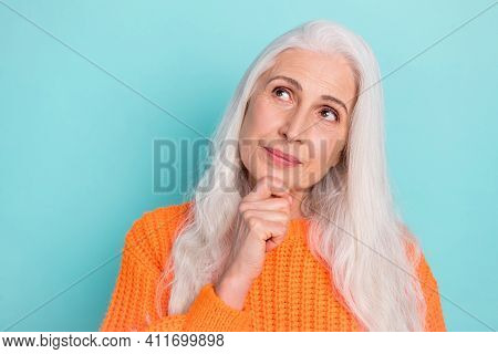 Close-up Portrait Of Attractive Creative Long-haired Woman Overthinking Touching Chin Copy Space Iso