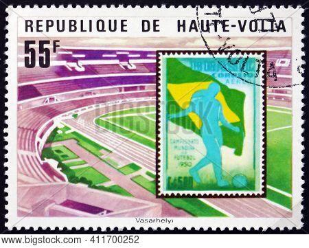Burkina Faso - Circa 1977: A Stamp Printed In Burkina Faso Shows Soccer Stadium And Brasilian Stamp,