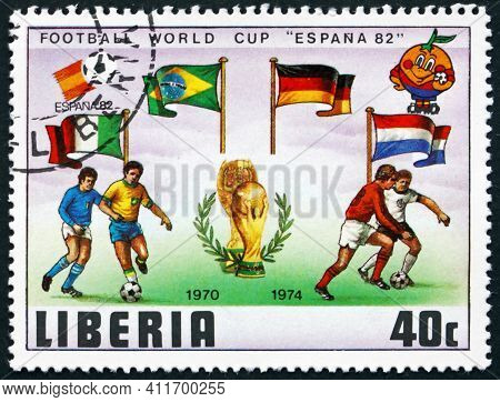Liberia - Circa 1981: A Stamp Printed In Liberia Shows Soccer Players And Flags Of 1970 And 1974 Fin