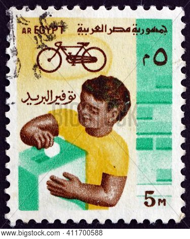 Egypt - Circa 1985: A Stamp Printed In Egypt Shows Boy With Box And Bike, Circa 1985