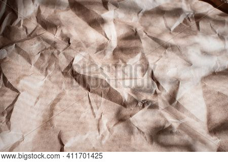 Wrinkled Craft Paper With Hard Shadows, For Packaging Goods And Gifts. The Background Is Craft Paper