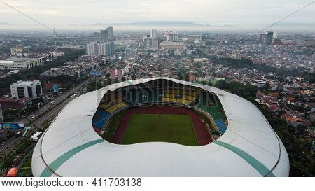 Aerial View Of The Largest Stadium Of Bekasi From Drone And Noise Cloud. Bekasi, Indonesia, March 9,