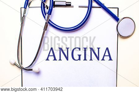 The Word Angina Is Written On A White Sheet Near The Stethoscope. Medical Concept