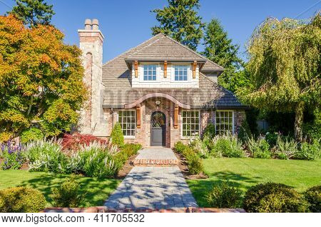 A perfect neighbourhood. Houses in suburb at Summer in the north America. Luxury houses with nice landscape.