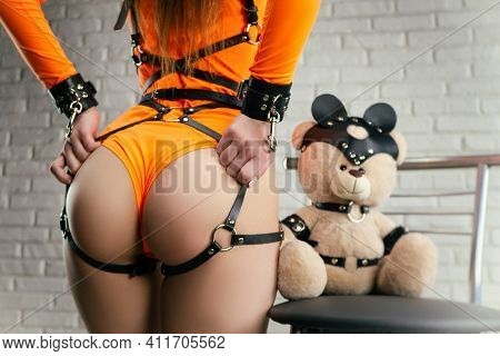 Nude Slender Woman Posing In Belt And Bdsm Accessory Bondage Sex Games