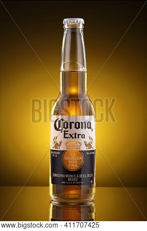 Lviv, Ukraine - April 30, 2020: Corona Beer In Bottle And Yellow Background