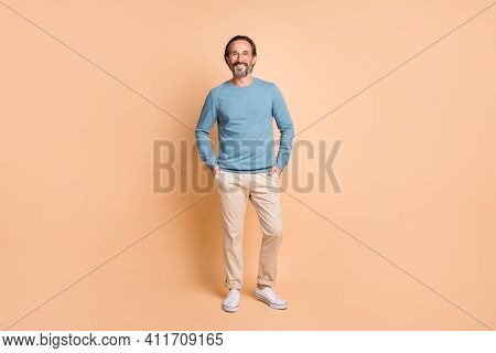 Full Length Photo Of Cool Business Man Wear Specs Blue Pullover Trousers Footwear Isolated Beige Col