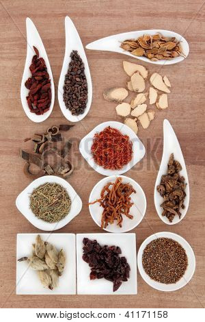 Chinese herbal medicine selection over papyrus background. poster