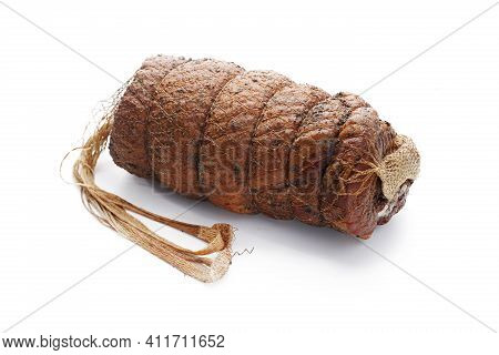 Smoked Rolled Bacon, Pork Belly In Herbs, In One Piece, Tied In String, Isolated On White Background
