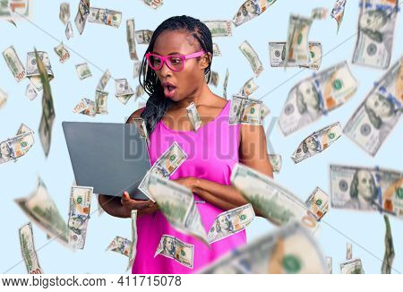 Young african american woman working using computer laptop scared and amazed with open mouth for surprise, disbelief face