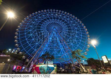 Rio De Janeiro, Brazil - January 18, 2021: Rio Star Ferris Wheel At Night Is Illuminated With Colorf