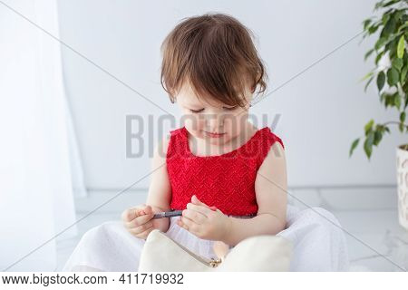 Little Girl Playing With Makeup, Holding A Red Pencil, Little Fashionista Model.