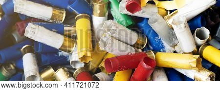 Hunting Blank Cartridges Of 12 Gauge Are Large Quantities. Many Shotgun Cartridges In Different Colo