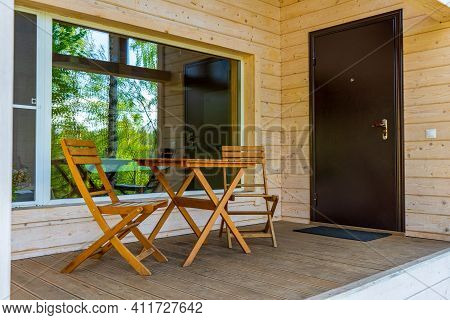 Terrace Of Wooden Eco Cottage House With Panoramic Window, Entrance Door, Table And Chairs. Cozy Wee