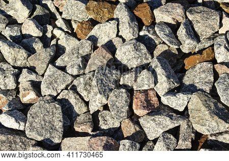 Background Of Natural Grey Granite Crushed Stone, Macadam. Macro Photo Of Texture Of Broken Stone Or