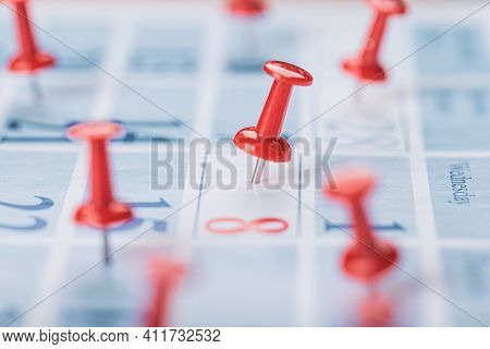 Calendar Page For 2021, Concept Image Of A Calendar With Red Push Pins.