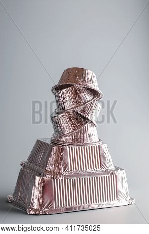 Balance Aluminum Foil Containers For Cooking On A Light Background. Foil Environmentally Friendly Bo