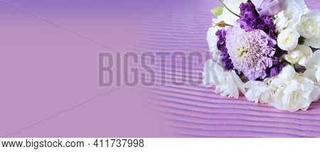 Lilac And White Flowers On A Lilac Background. Festive Flower Arrangement. Lilac Bouquet. Background