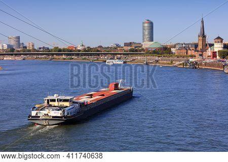 Dusseldorf, Germany - September 19, 2020: Freight Shipping Barge On River Rhine In Dusseldorf, Germa