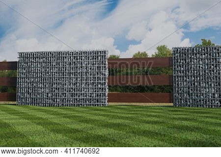 3d Rendering Of Green Garden With Gabion Wall And Wooden Planks