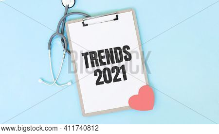 Grey Stethoscope And Paper Plate With A Sheet Of White Paper With Text Trends 2021 Light Blue Backro