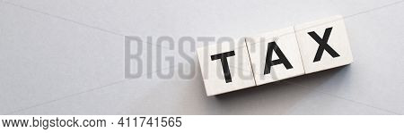 Tax Concept With Wooden Blocks On Table