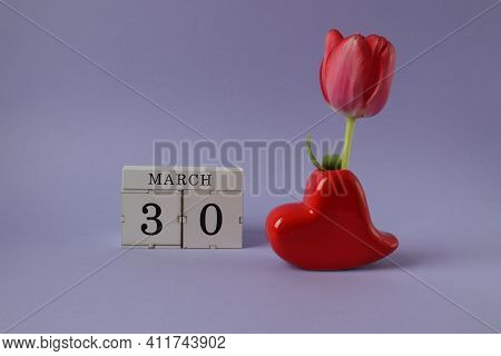 Calendar For March 30: Cubes With The Number 30, The Name Of The Month March In English, A Heart-sha