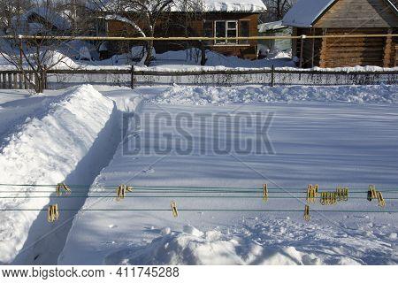 Snowy Vegetable Garden In The Winter. Ragging Snow Paths In The Garden In Winter. High Snowdrifts In