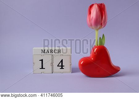 Calendar For March 14: Cubes With The Number 14, The Name Of The Month March In English, A Heart-sha