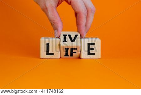 Live Your Life Symbol. Businessman Turns Cubes And Changes The Word 'live' To 'life'. Beautiful Oran