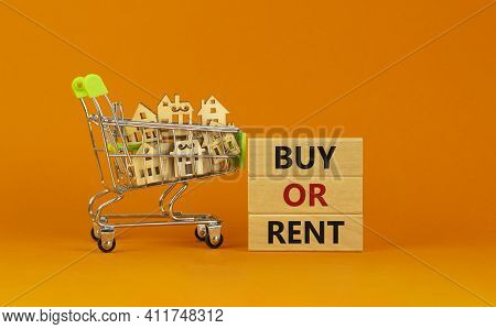 Buy Or Rent Real Estate Symbol. Wooden Blocks With Words 'buy Or Rent' On Beautiful Orange Backgroun