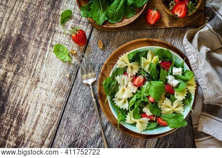 Italian Pasta Salad With Strawberries, Arugula, Nuts, Soft Cheese Dressed With Balsamic Sauce On The