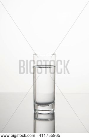 Glass Of Water Isolated On White Background. Water In Glass