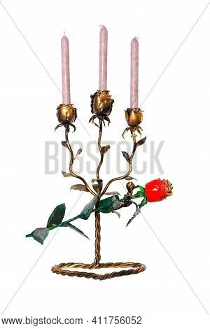 On A Twisted Stand Stands A Beautiful Brass-colored Forged Metal Candlestick In The Form Of Rosebuds