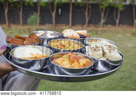 Traditional Farali Indian Food Served In Thali And Bowls With Many Items For Upawaas Upwas Or Vrat K