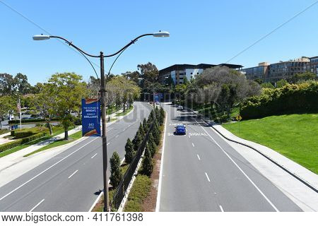IRVINE, CALIFORNIA - 16 APRIL 2020: Campus Drive fFrom Watson Bridge that connects University Center with The University of California Irvine.