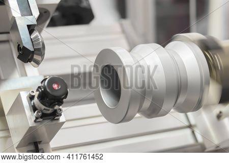 Turning Milling Machine Cutting Metal Workpiece At Factory, Plant, Exhibition. Metalworking, Engravi