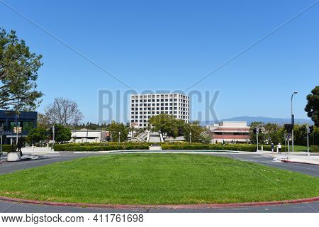 IRVINE, CALIFORNIA - 16 APRIL 2020: Bus Loop looking toward the Wilkening Rose Garden, Watson Bridge and University Center.
