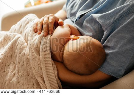 Mom And Newborn Baby Resting After Breastfeeding