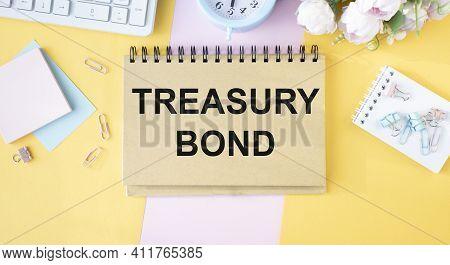 Treasury Bond Concept Write Text On Notebook