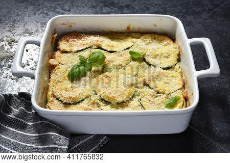 Zucchini Gratin With Béchamel Sauce And Parmesan On A Dark Concrete Background. Summer Pie With Zucc