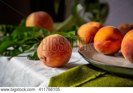 Still Life Peaches Fruit. Peaches On Table In Kitchen Near Window. Rustic Minimalism Food Peach Frui