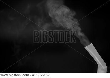 Medical Equipment For Inhalation. Compressor Nebulizer On A Black Background. Respiratory Medicine.